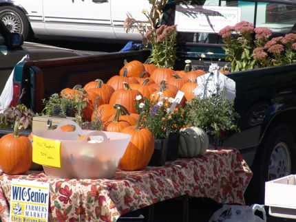 Pumpkins sit atop a farmer\'s table at the Yakima Farmers\' Market during the autumn months.