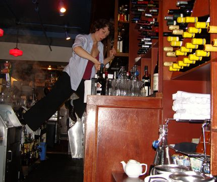 A dedicated server risks life and limb at Place Pigalle in the Pike Place Market!