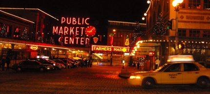A cab zips by the entrance to the Pike Place Market during the holiday season 2008.