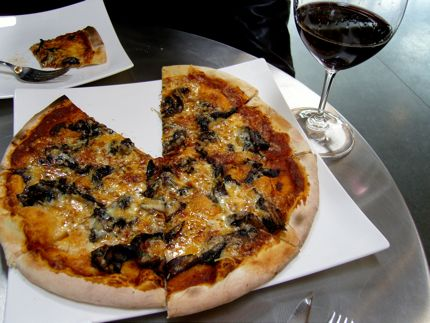 A warm mushroom pizza and a good glass of Syrah fit the bill at Novelty Hill/Januik Winery in Woodinville.