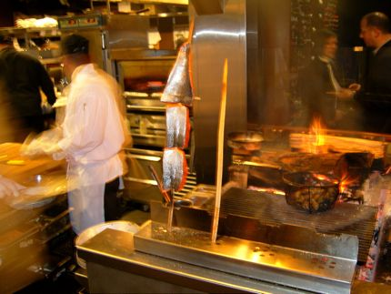 Cooking salmon in the traditional manner at Blackfish restaurant at Tulalip Resort Casino in Marysville, Washington.