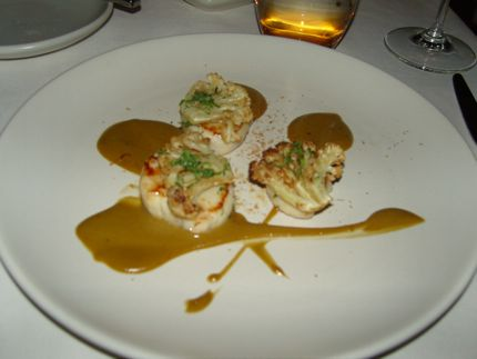 An appetizer of scallops shines at Market, Jean-Georges Vongerichten\'s new restaurant in Vancouver, BC. 