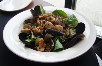 The Warm Seafood Salad at O\'Doul\'s in Vancouver\'s Listel Hotel is a signature dish.