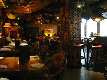 Enjoy the South Seas ambience at the Tiki Bar at Trader Vic\'s in Bellevue, Washington.